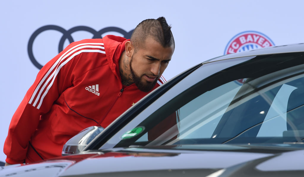 Bayern Munich's Chilean midfielder Arturo Vidal looks in to a car during a car handover event at the Audi headquarters in Ingolstadt, southern Germany, on October 11, 2017. / AFP PHOTO / Christof STACHE (Photo credit should read CHRISTOF STACHE/AFP/Getty Images)